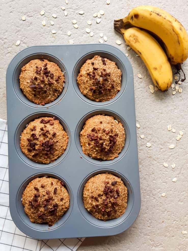 Vegan banana oatmeal muffin in muffin pan