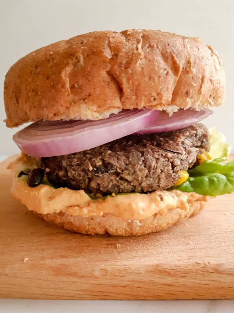 A sideview of black bean burgers