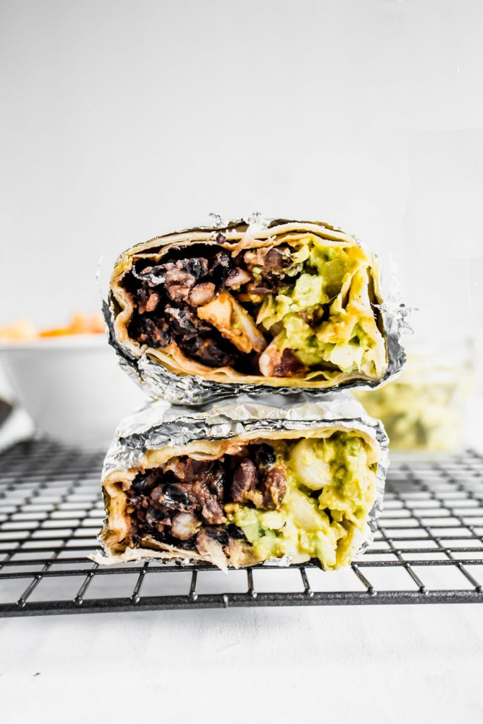 A side shot of vegan black beans and tofu burritos