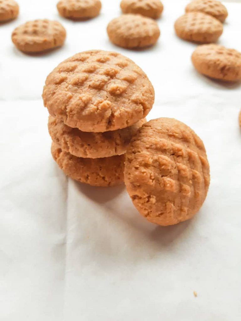 A side shot of 3 peanut butter cookies stacked together