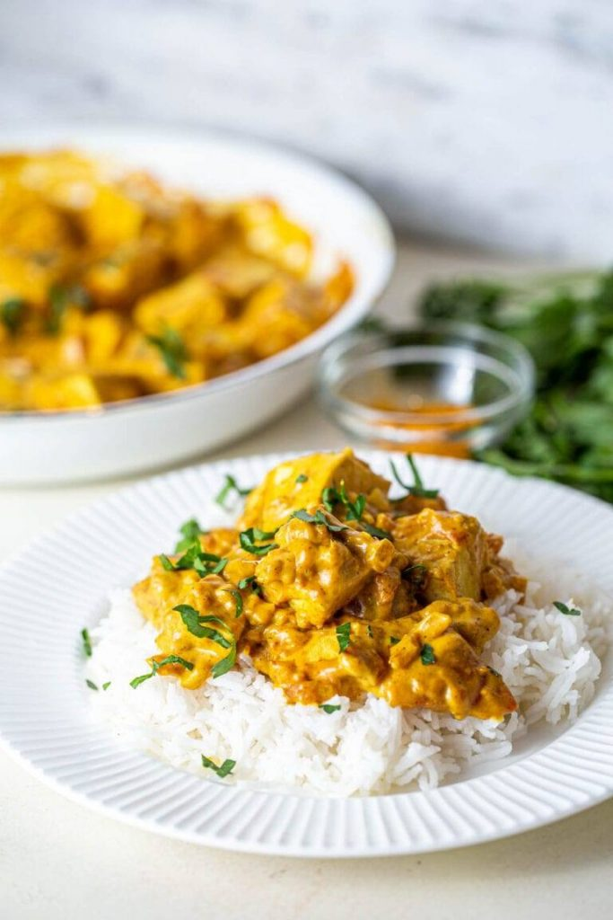 Vegan butter chicken served on a bed of white rice