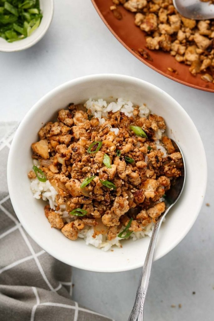 Tofu mince served on a bed of white rice in a bowl