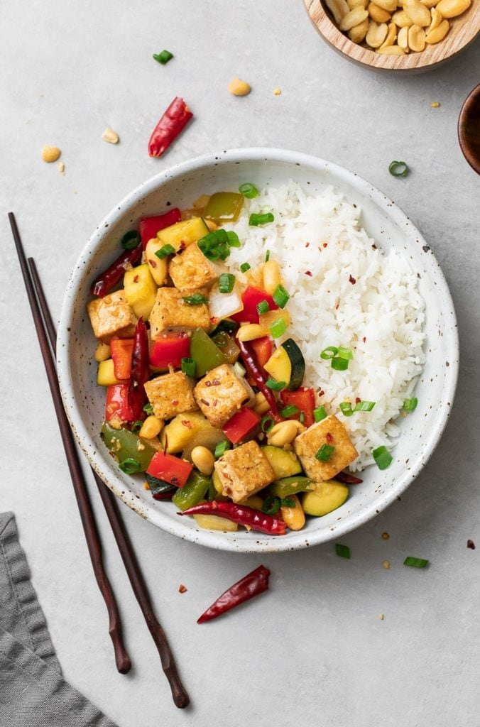 kung pao tofu served with a side of rice in a bowl