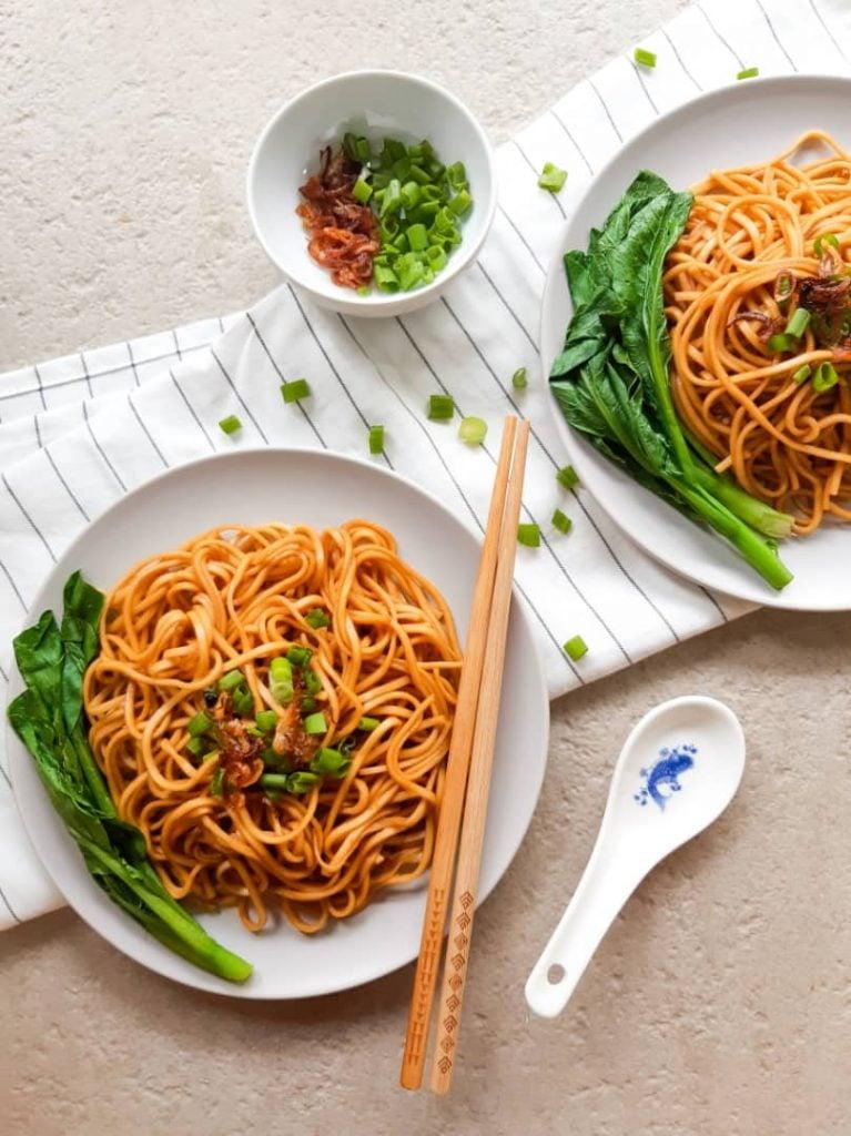 An overhead shot of 2 bowls of wonton noodles