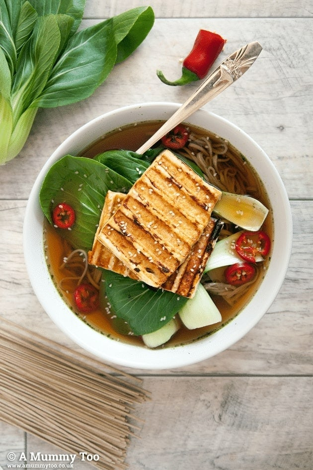 Ramen soup served in a white bowl topped with grilled tofu