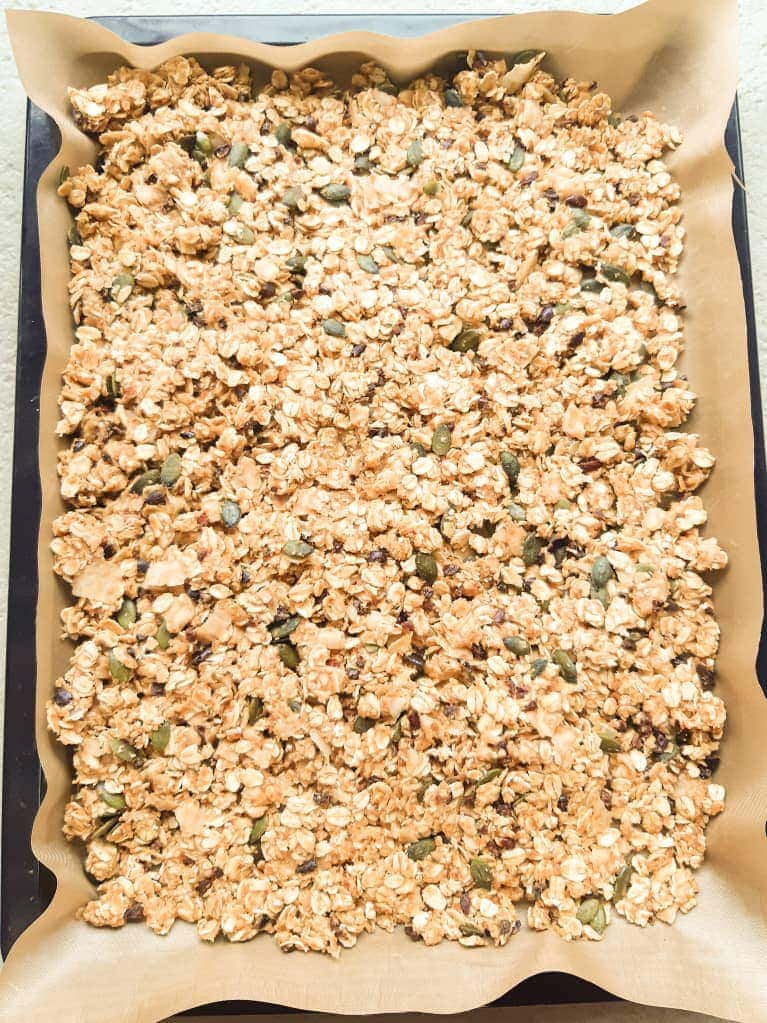 Unbaked granola in a baking pan