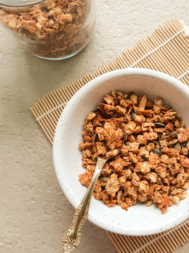 A side view of granola served in a bowl