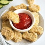 Chicken nugget served with tomato sauce