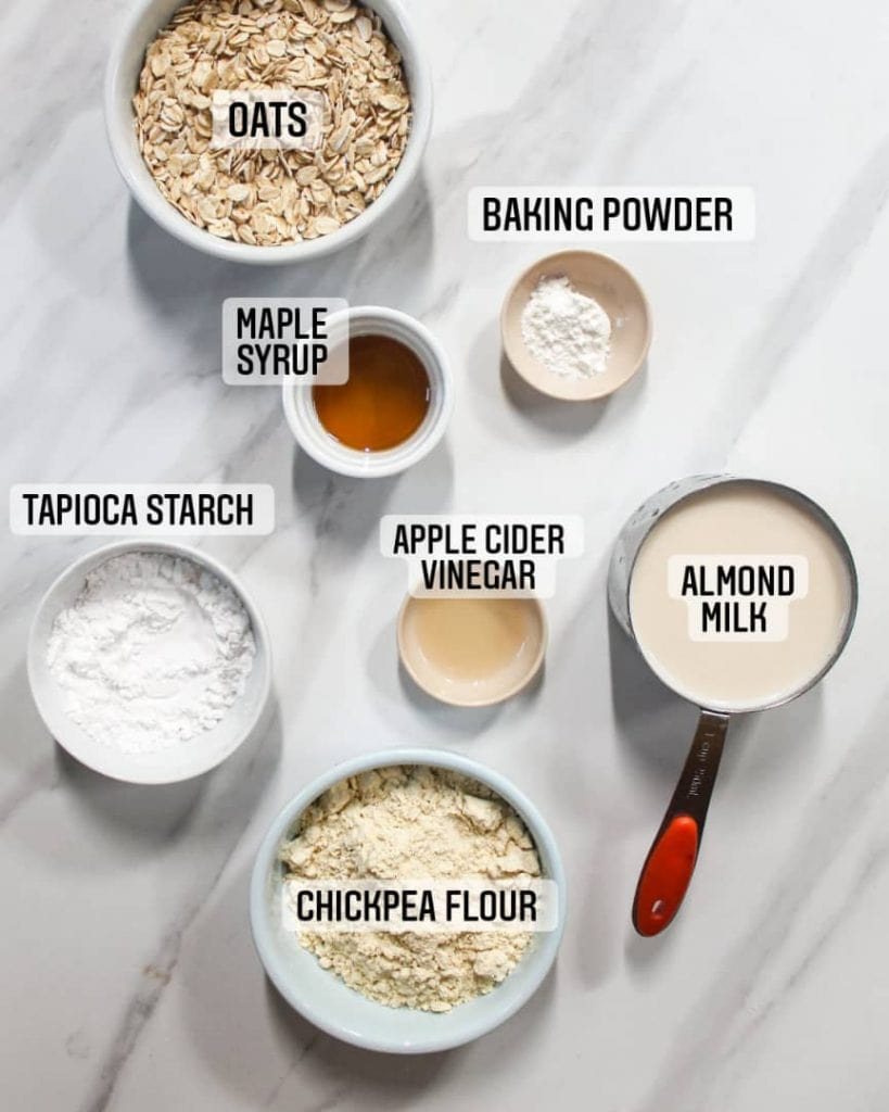 Ingredients needed for crepes like oats, chickpea flour, tapioca starch, almond milk, apple cider vinegar, baking powder and maple syrup