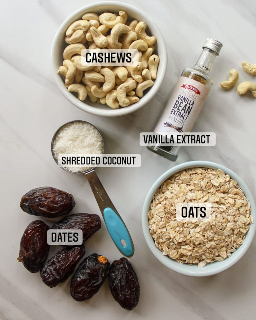 Ingredients needed like raw cashews, oats, desiccated coconut, vanilla extract and dates