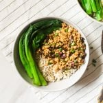 Tofu mince served with some brown rice and choy sum topped with chopped scallions