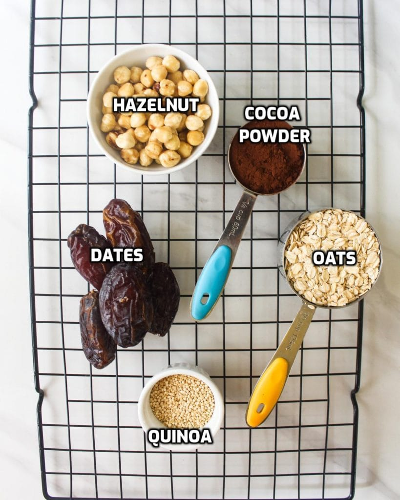 Ingredients needed for this recipe - dates, quinoa, oats, cocoa powder, hazelnuts and quinoa.