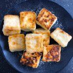 Tofu cubes arranged on a blue plate