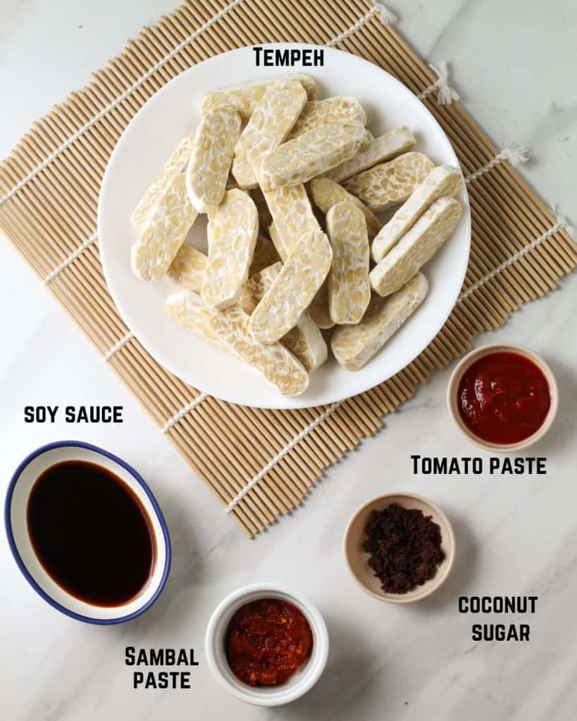 Ingredients needed for this dish like tempeh, soy sauce, sambal, coconut sugar and tomato paste