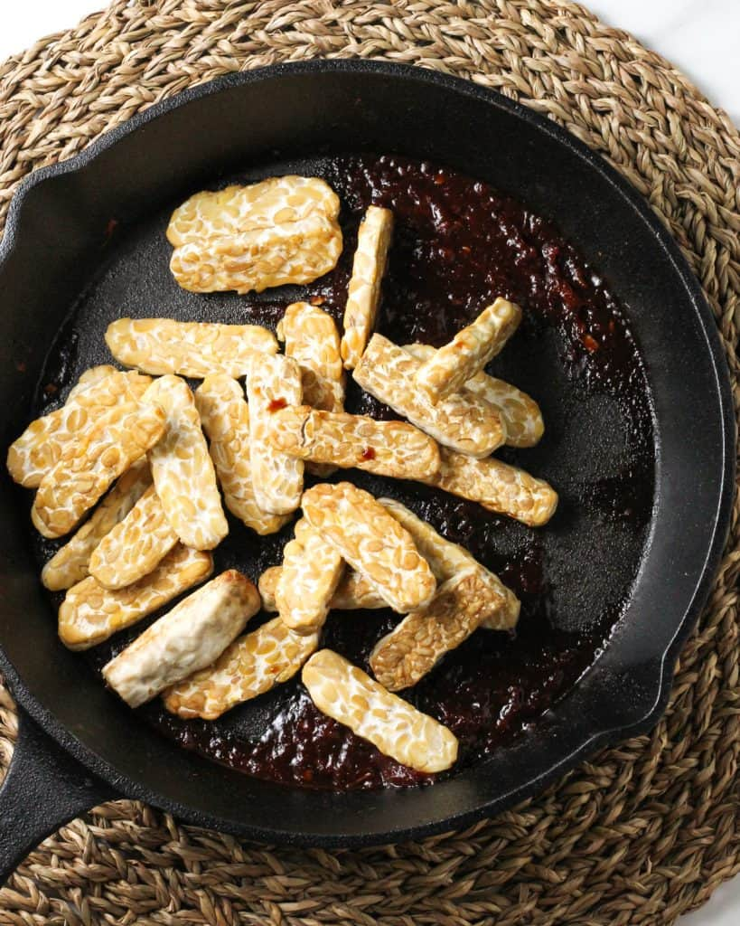 Adding the tempeh back to the pan