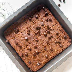 Brownies baked in a black square baking pan