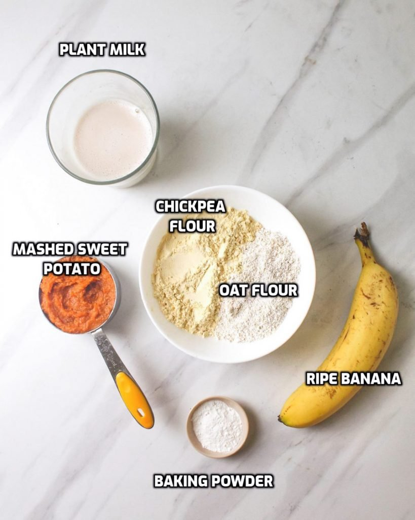 Ingredients needed for pancakes like plant milk, chickpea flour, oat flour, banana, mashed sweet potato and baking powder