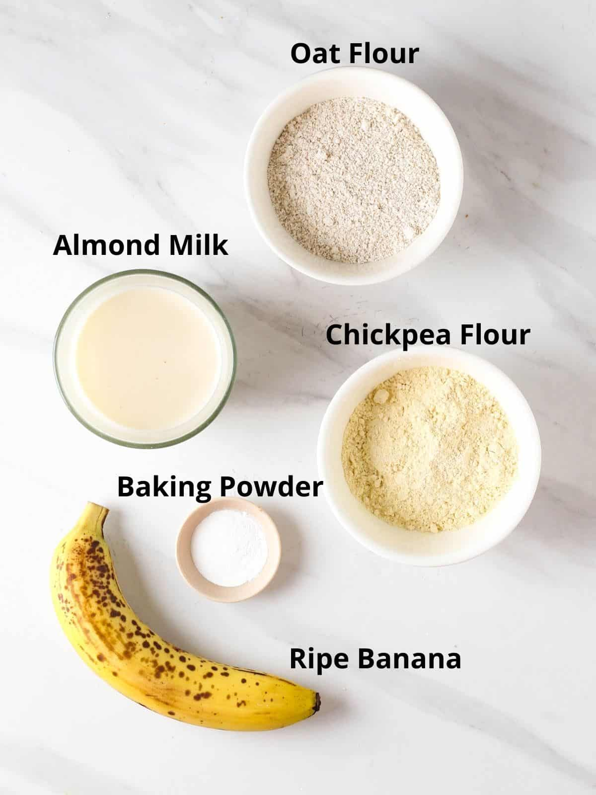 Ingredients needed like oat flour, chickpea flour, almond milk, baking powder and banana.