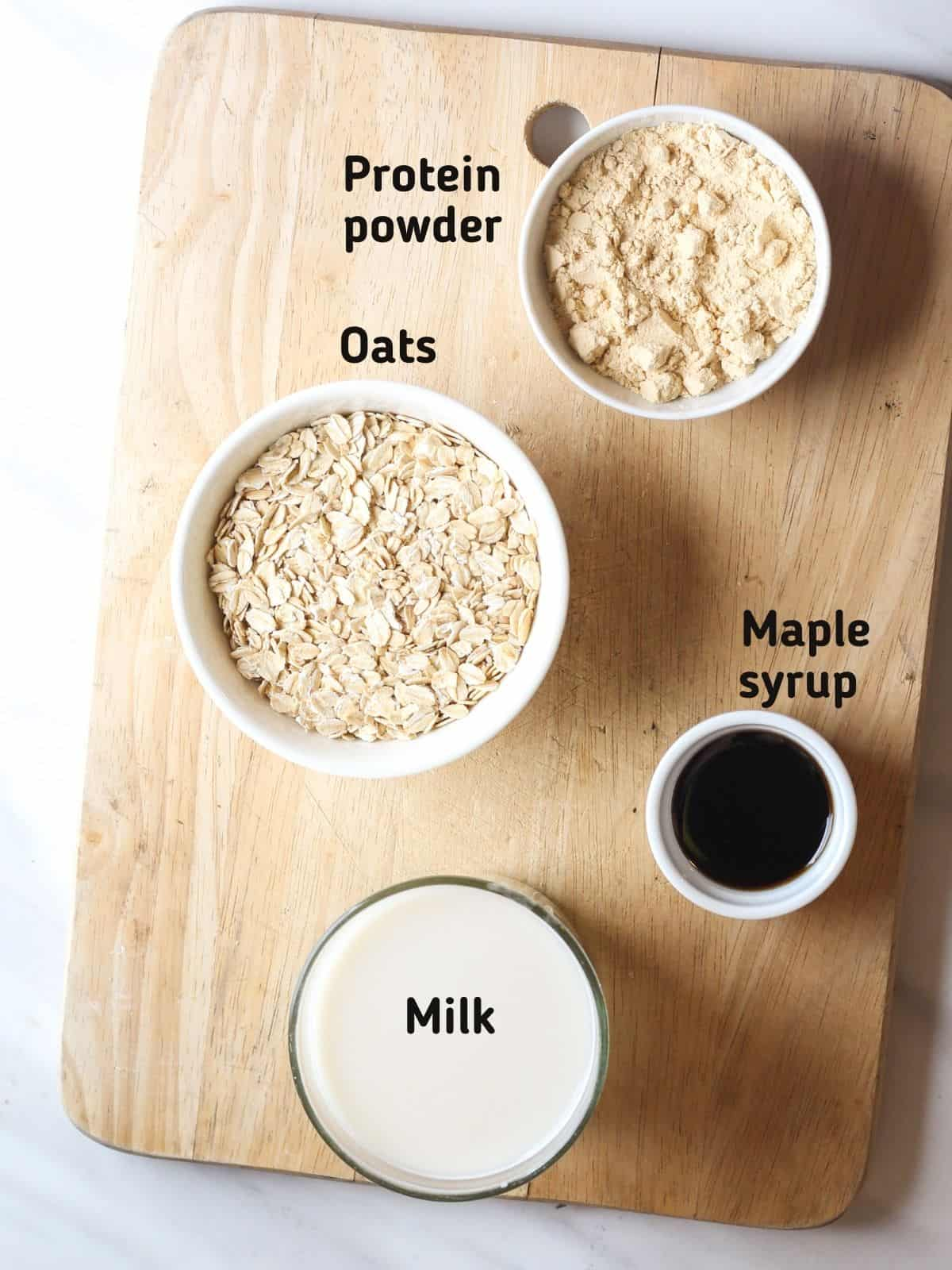 Ingredients needed like oats, protein powder, maple syrup and milk
