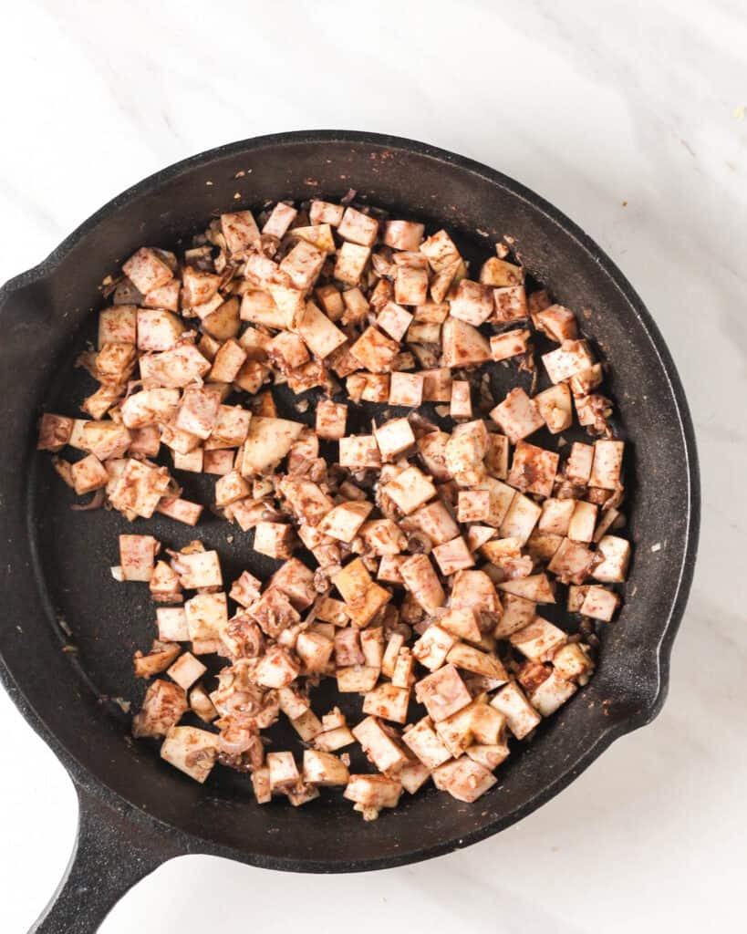 Adding yam and five spice powder to the pan.