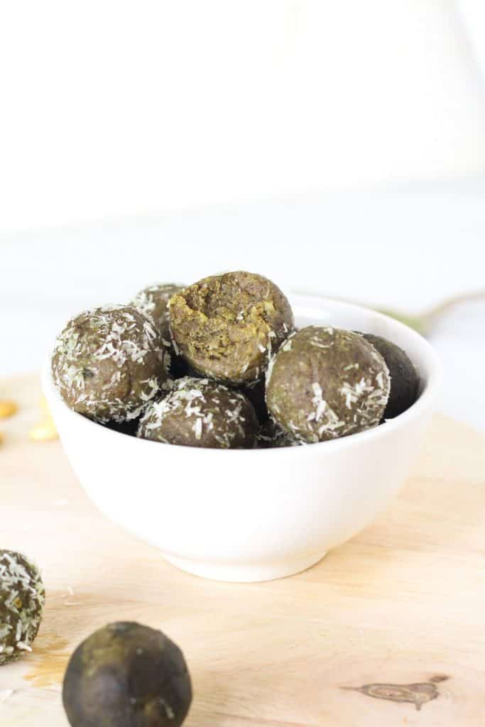 A close up of protein balls in a white bowl