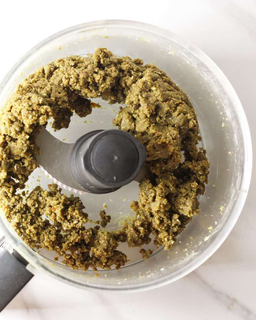 Food processor containing dough of protein balls