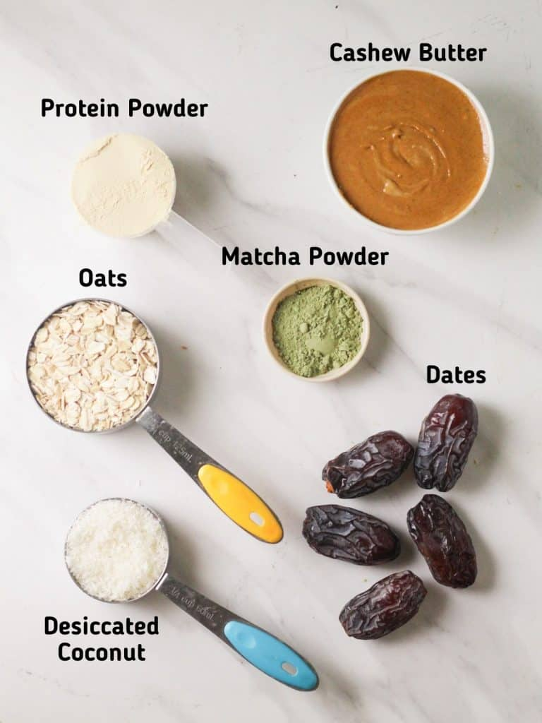 Ingredients needed like protein powder, oats, desiccated coconut, dates, matcha powder and cashew butter