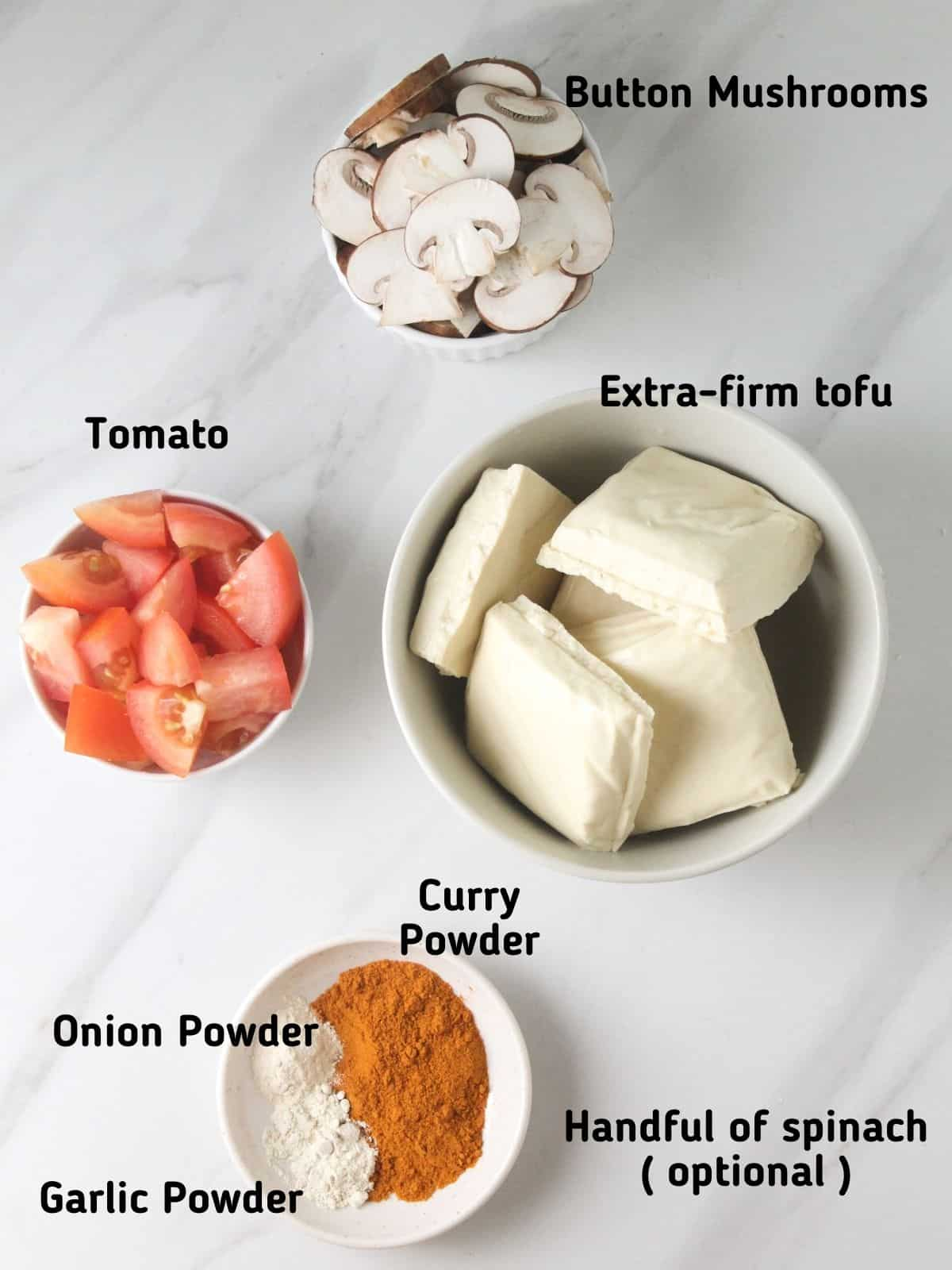 Ingredients needed like mushroom, tomato, tofu, curry powder, onion powder and garlic powder.