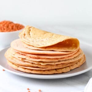 A close up look of a stack of tortillas.