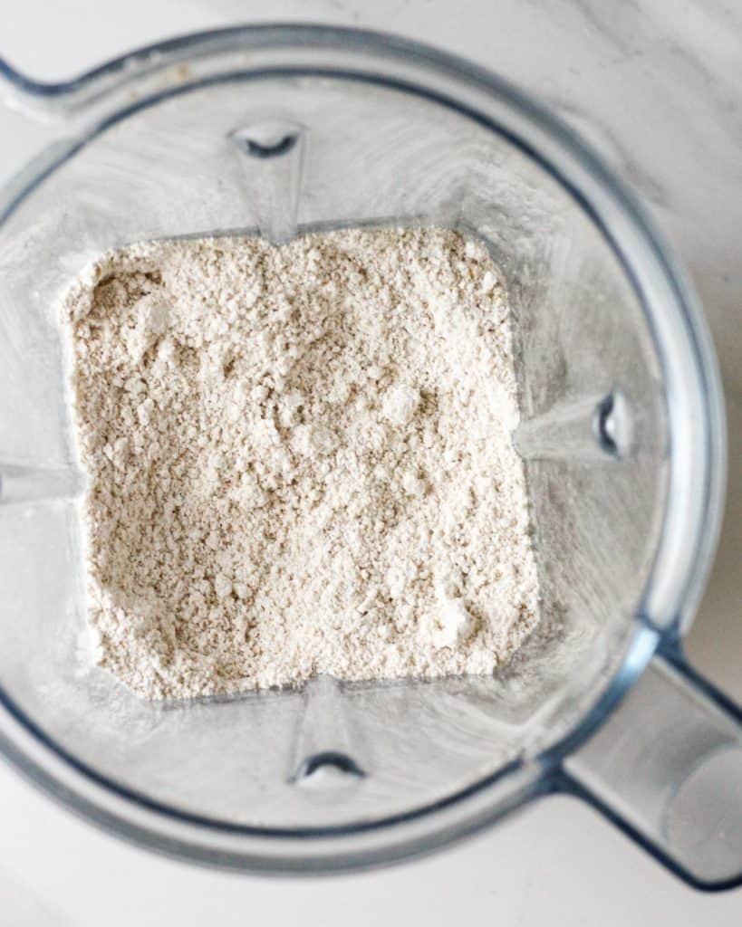 Blending oats into flour in a blender