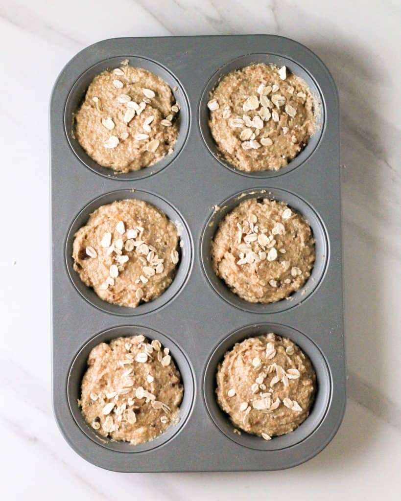 Muffin batter in a muffin tray