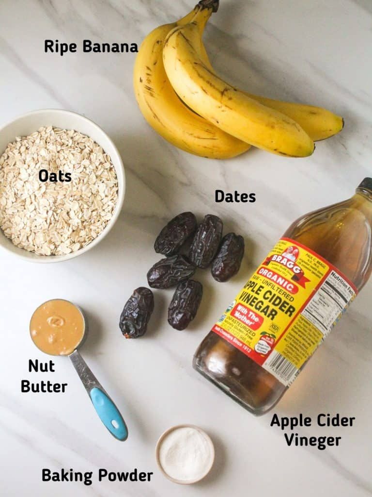 Ingredients needed for this recipe like bananas, oats, apple cider vinegar, nut butter, dates and baking powder