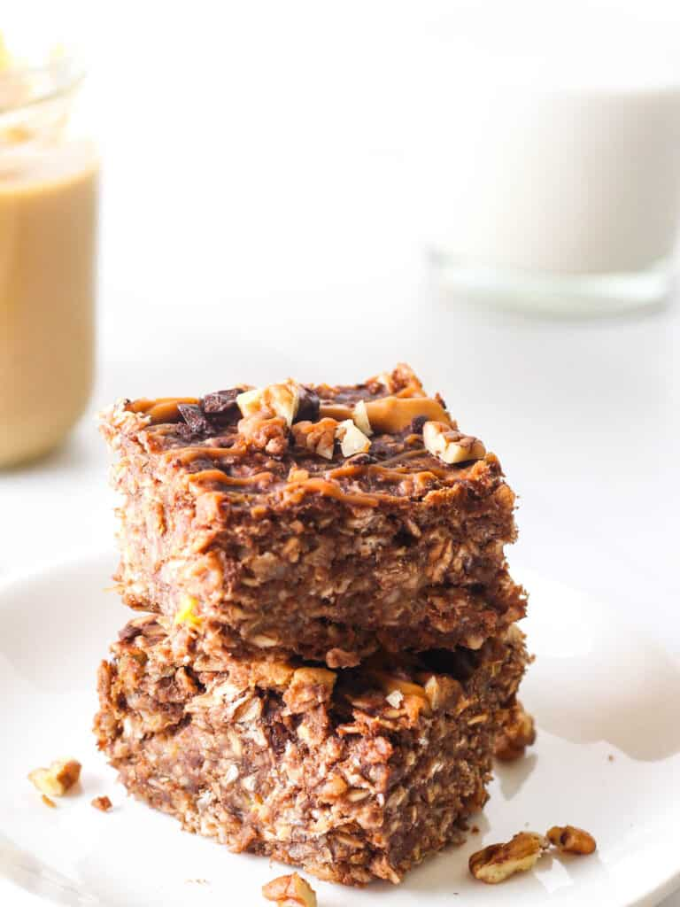 2 slices of chocolate banana baked oatmeal stacked on top of each other.