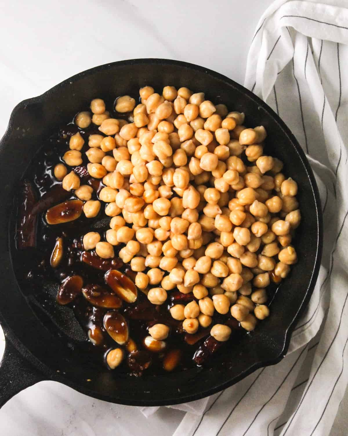 Adding chickpeas into the skillet