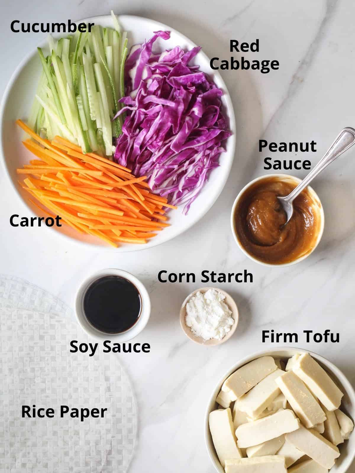 Ingredients needed in this recipe like carrot, cabbage, cucumber, peanut sauce, soy sauce, corn starch and tofu.
