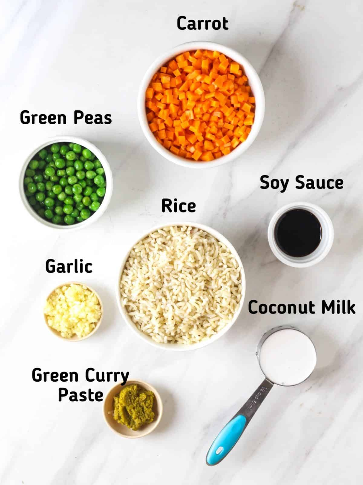 Ingredients needed like green peas, carrot, rice, garlic, green curry paste, coconut milk and soy sauce.