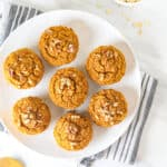 An overhead shot of sweet potato muffins arranged on a white plate.