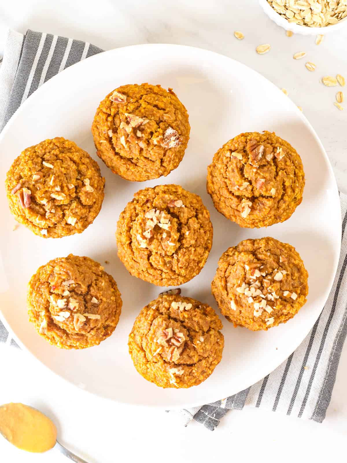 Sweet potato oatmeal muffins on a plate.
