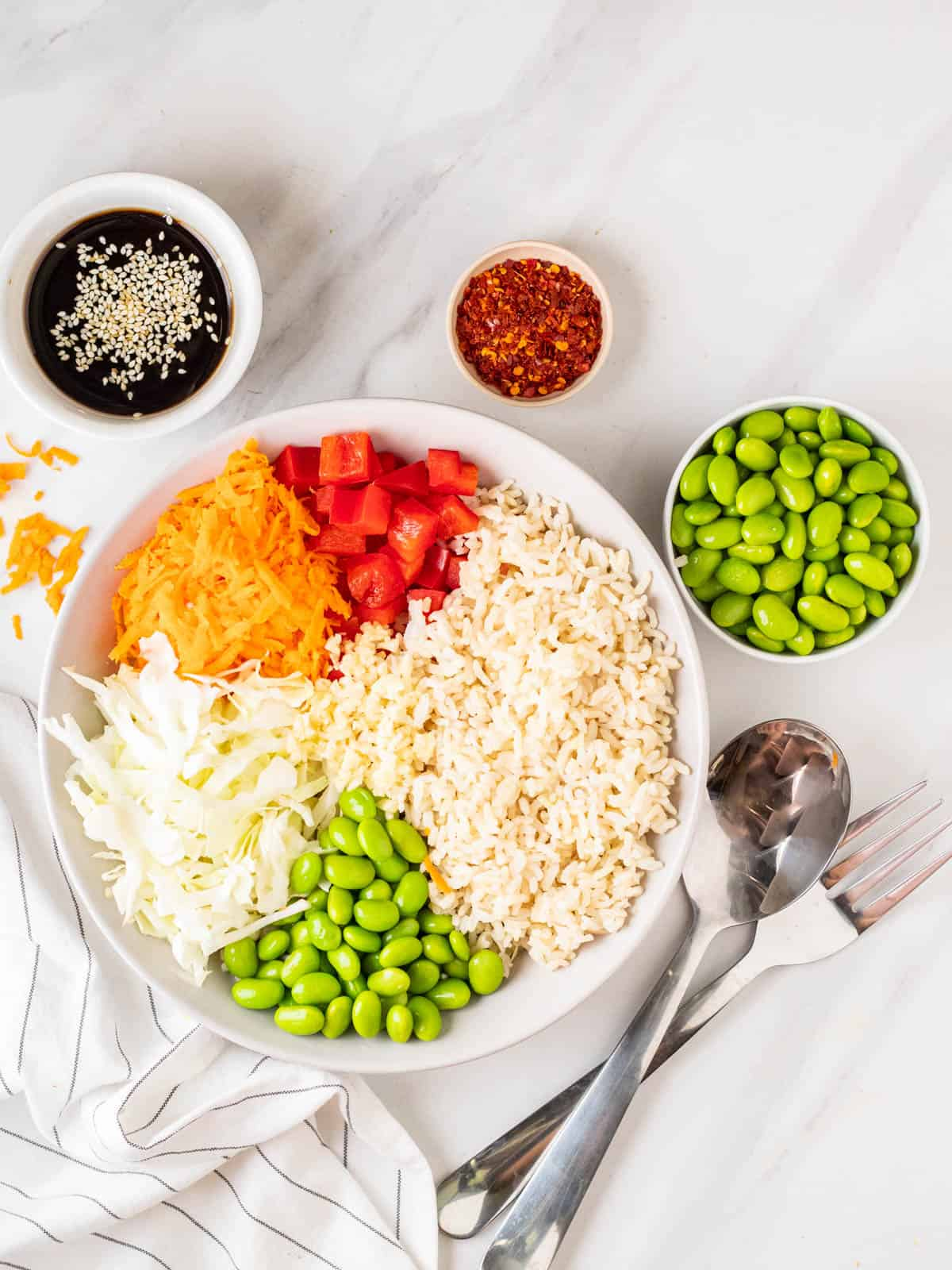 Vegan rice salad with components separated in a bowl.