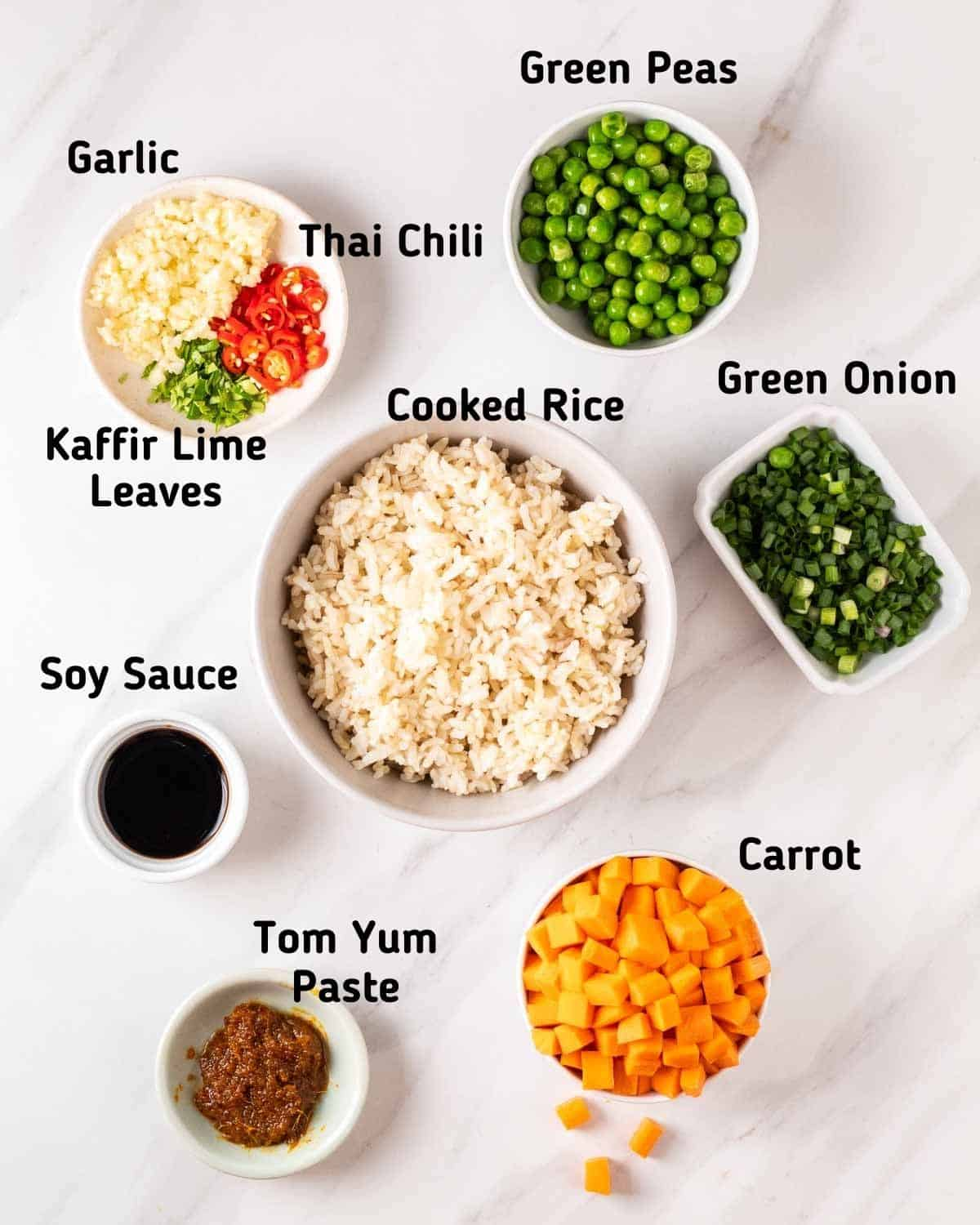 Ingredients needed to make tom yum fried rice.