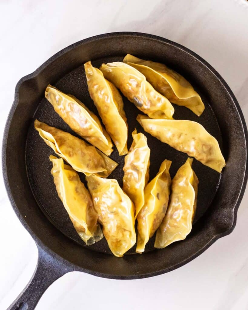 Cooking dumplings in a cast iron skillet