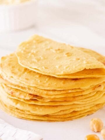 Side shot of a stack of chickpea flour tortillas.