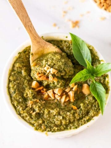 A close up of thai basil pesto in a white ramekin.