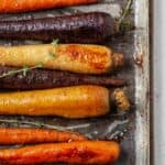 Air fryer carrots arranged on a baking tray.