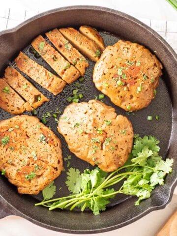 Seitan chicken in a cast iron pan.