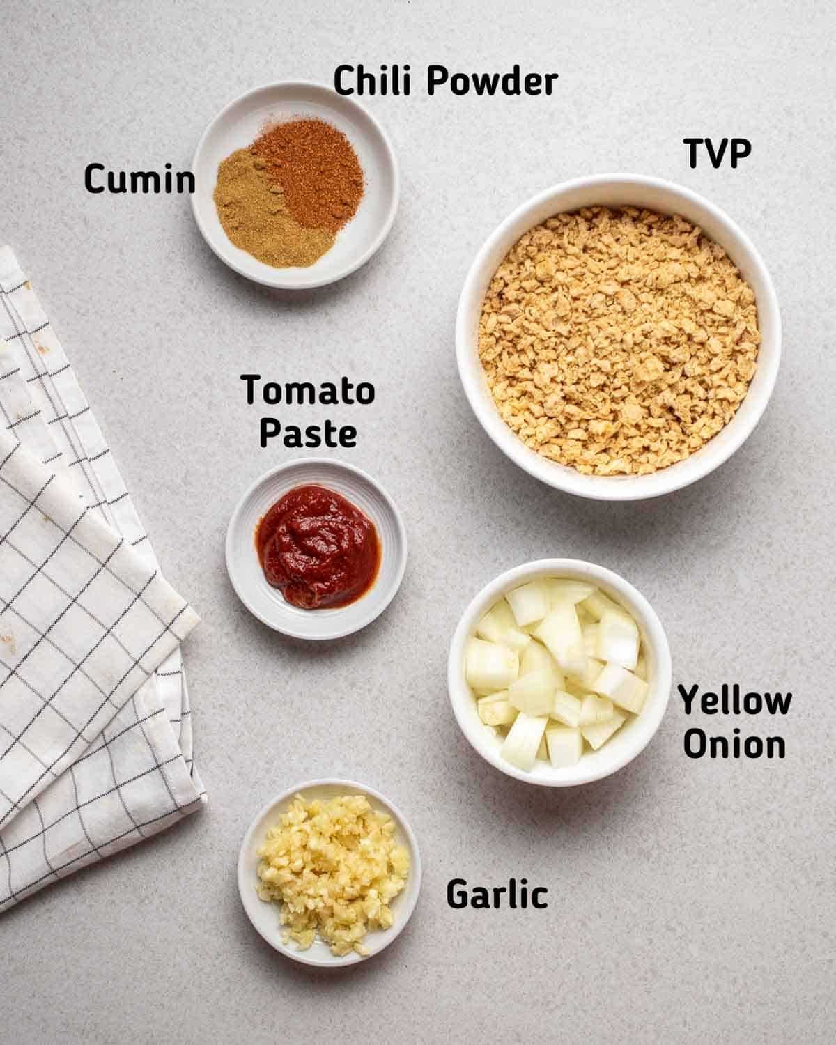 Ingredients needed to make this recipe like TVP, onion, garlic, tomato paste and spices.