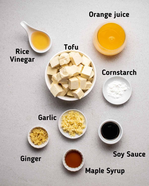 Ingredients needed like tofu, orange juice, garlic, ginger, cornstarch and other seasonings.