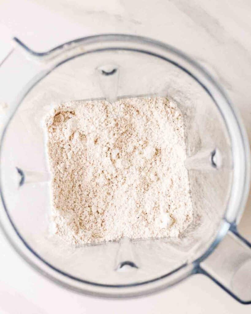 Showing blended oats in a blender.