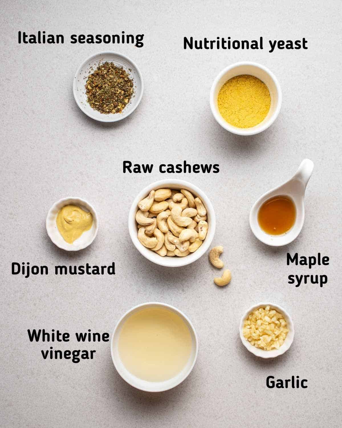 Ingredients needed for dressing like cashews, nutritional yeast, garlic and other seasonings.