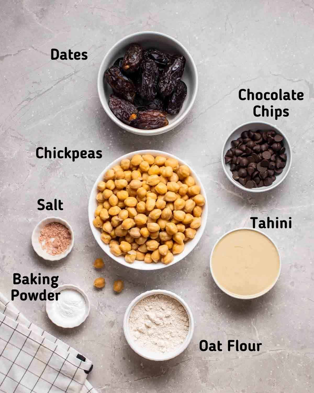 Ingredients needed like chickpeas, dates, tahini, flour, baking powder, salt and chocolate chips.